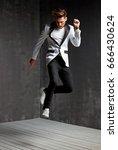 handsome young man dancing on... | Shutterstock . vector #666430624