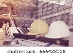 safety hardhats on desk in... | Shutterstock . vector #666433528