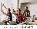 excited young colleagues... | Shutterstock . vector #666466729