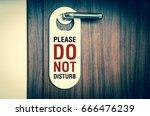 door of hotel room with sign... | Shutterstock . vector #666476239