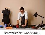leather handbag craftsman at... | Shutterstock . vector #666483010