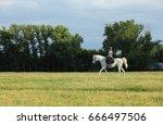 girl riding her white arabian...   Shutterstock . vector #666497506