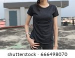 Close up of woman in black T- shirt and Jeans