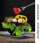 Small photo of Healthy food, fresh vegetables salad in salad bowl
