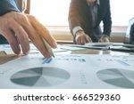 business team meeting present.... | Shutterstock . vector #666529360