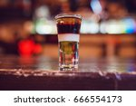 a cocktail made by layers. shot ... | Shutterstock . vector #666554173