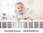 cute little baby standing in... | Shutterstock . vector #666560014