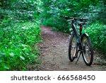mountain biking down hill... | Shutterstock . vector #666568450