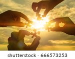 collaborate four hands trying... | Shutterstock . vector #666573253