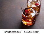 manhattan cocktail with whiskey.... | Shutterstock . vector #666584284