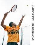 preparing to his best serve.... | Shutterstock . vector #666600844