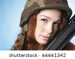 young army woman holding her... | Shutterstock . vector #66661342