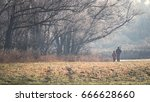 panorama with two hunters at...   Shutterstock . vector #666628660