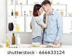 happy couple in love cooking... | Shutterstock . vector #666633124