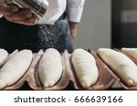 baker making bread at a bakery. ... | Shutterstock . vector #666639166