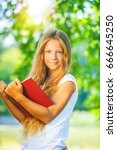young beautiful girl reads red... | Shutterstock . vector #666645250
