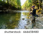 trout fishing in the mountain... | Shutterstock . vector #666658480