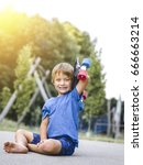blond boy playing on a children ... | Shutterstock . vector #666663214