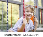 blond boy playing on a children ... | Shutterstock . vector #666663244