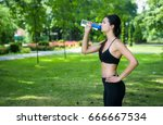 fitness woman drinks water from ... | Shutterstock . vector #666667534
