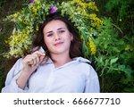 beautiful girl in wreath of... | Shutterstock . vector #666677710