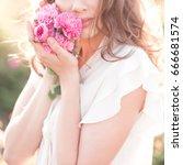 woman holding roses closeup.... | Shutterstock . vector #666681574