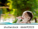 asia child girl brush their... | Shutterstock . vector #666692023