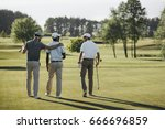 Back View Of Multiethnic Golf...