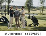 multiethnic golfers with golf... | Shutterstock . vector #666696934