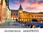 Colorful spring sunset on the main square of City of Bologna with Palazzo d