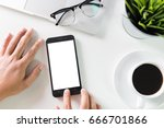 use a smartphone on the desk. | Shutterstock . vector #666701866
