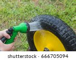 Small photo of in the shower wash the wheel from the garden truck.