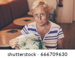 old woman tourist sitting with... | Shutterstock . vector #666709630