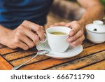 man is holding cup of tea with... | Shutterstock . vector #666711790
