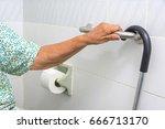 elderly woman holding a grab... | Shutterstock . vector #666713170