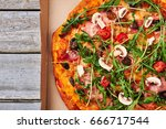 pizza with salami and greenery. ... | Shutterstock . vector #666717544