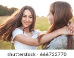 two nice females are spinning... | Shutterstock . vector #666722770