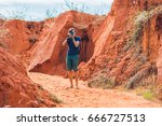 young man in red canyon near... | Shutterstock . vector #666727513