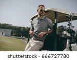 stylish golfer holding golf... | Shutterstock . vector #666727780
