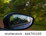 backview mirror of the car... | Shutterstock . vector #666741103