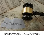 Small photo of First Amendment news headline on a copy of the US Constitution with gavel