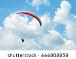 Paraglider Flies Paraglider In...