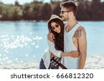 young smiling interracial... | Shutterstock . vector #666812320