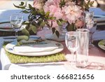 decorated table with flowers... | Shutterstock . vector #666821656