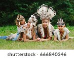 happy children playing native... | Shutterstock . vector #666840346