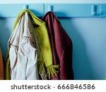coats on hooks | Shutterstock . vector #666846586