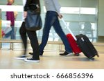 airport commuters with luggage... | Shutterstock . vector #666856396