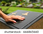 woman's hand touching the black ... | Shutterstock . vector #666865660