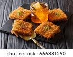 sweet oriental dessert kunafeh... | Shutterstock . vector #666881590