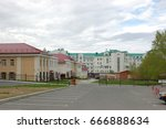 Small photo of 09 June 2013. The Town Of Khanty-Mansiysk. Parking in yards, landscaping,road markings, barriers in the yard